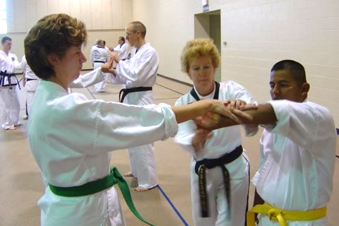 Ms. Soldalke assisting two students at the 2007 Sioux Falls Clinic